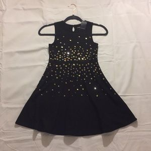 a girls black with sequined dress